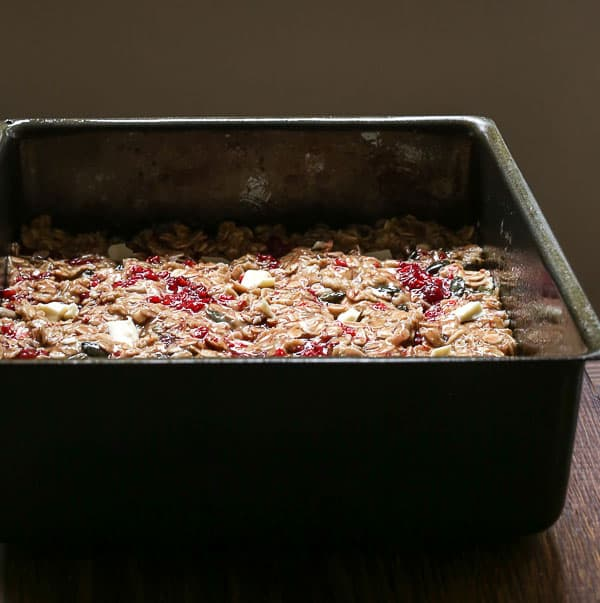 A baking tin of White Chocolate Raspberry Flapjacks pre-oven
