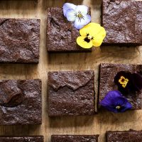 Overhead shot of almond flour brownies on a wooden board