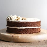 gluten-free Coffee and Walnut Cake on a wooden board