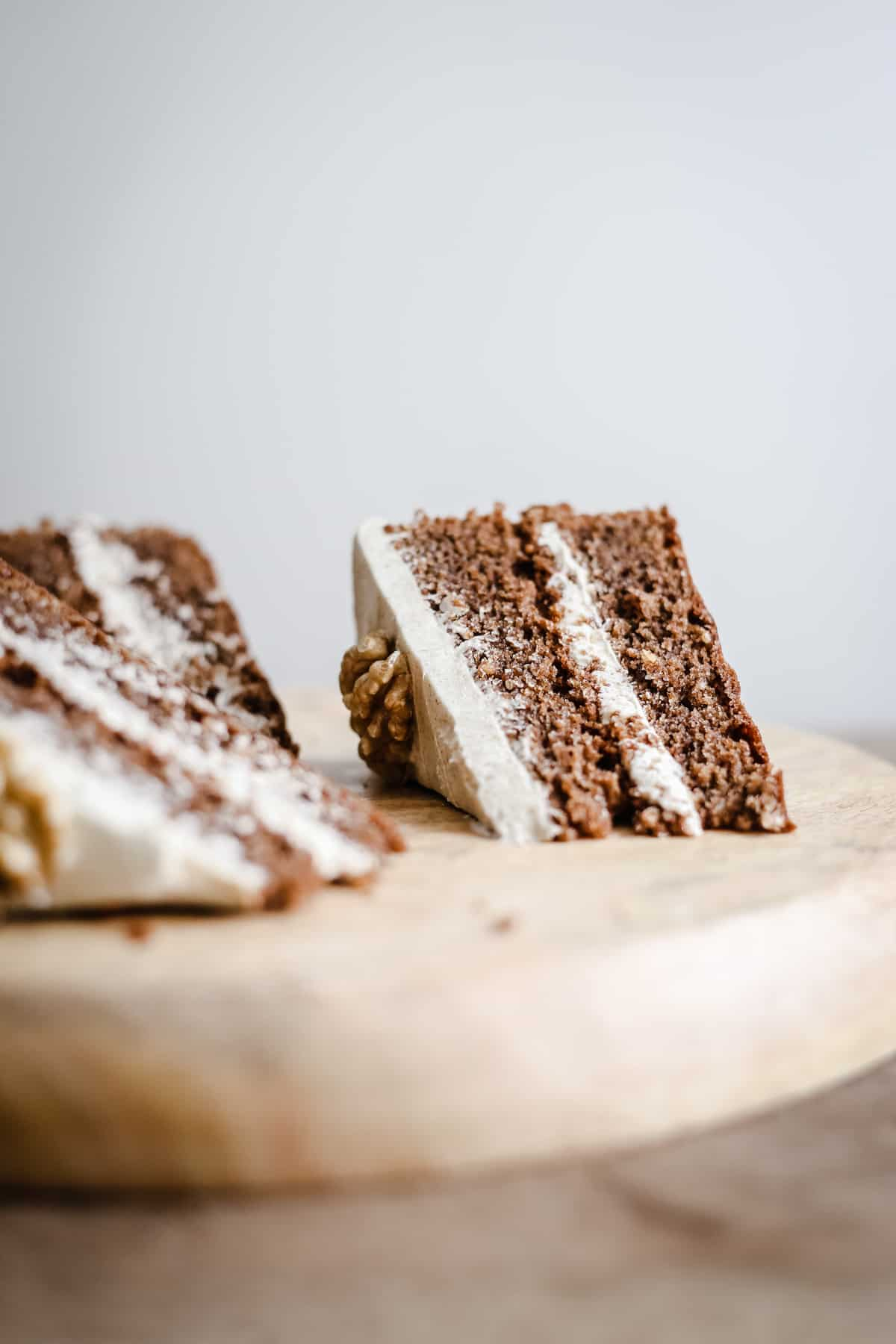 Slices of gluten-free Coffee and Walnut Cake on a wooden board