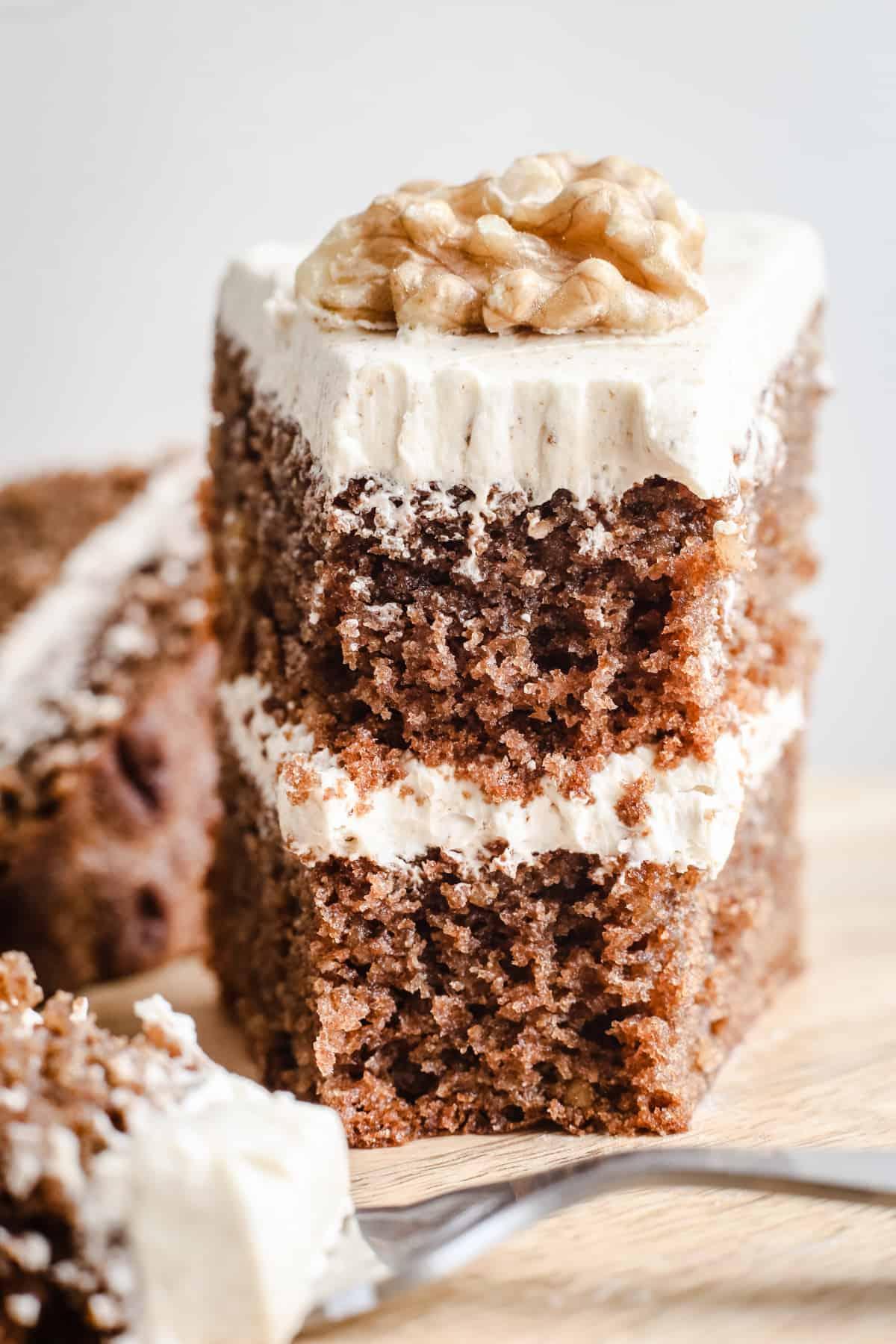 Cut slice of a gluten-free Coffee and Walnut Cake