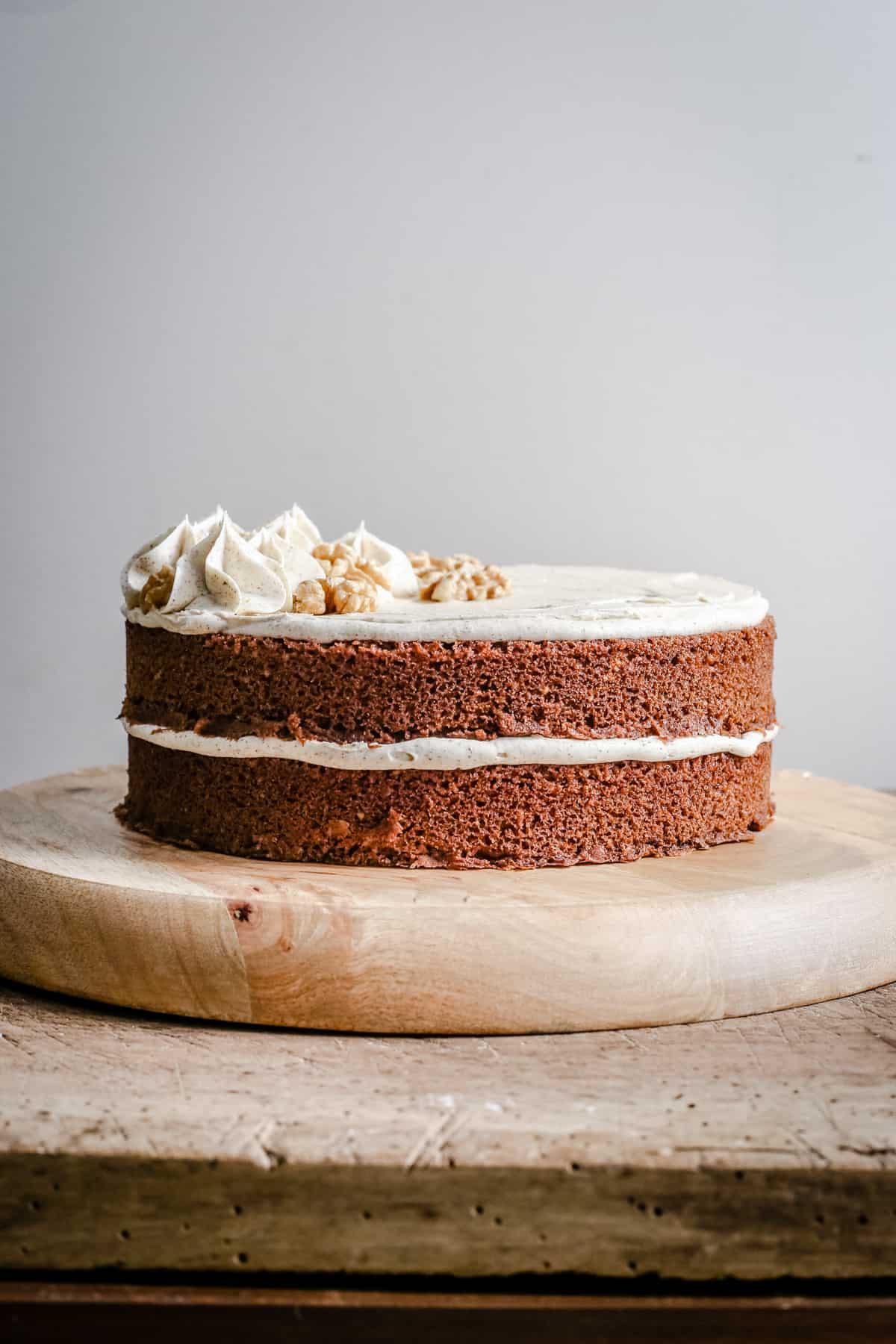 gluten-free Coffee and Walnut Cake on a wooden board