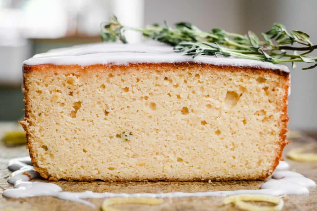 close up of a cut slice of whole lemon cake