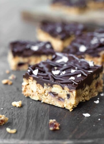 Close up of Chocolate Tiffin Bar on a wooden board