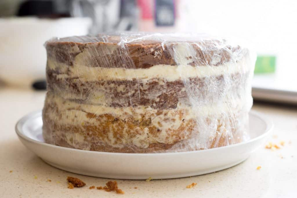 Lemon Raspberry Cake wrapped in cling film ready for the fridge