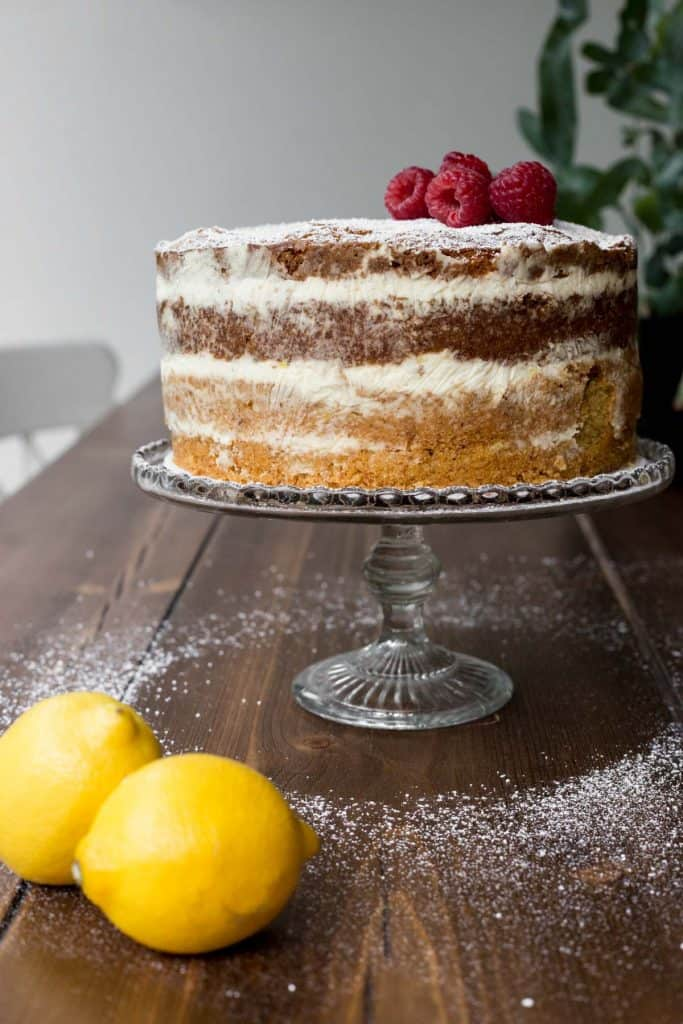 Lemon Raspberry Cake on a cake stand