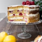 Cut Lemon Raspberry Cake on a cake stand