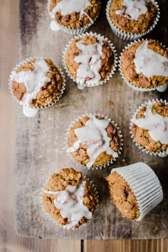 overview of Pumpkin Oatmeal Muffins on a wooden board