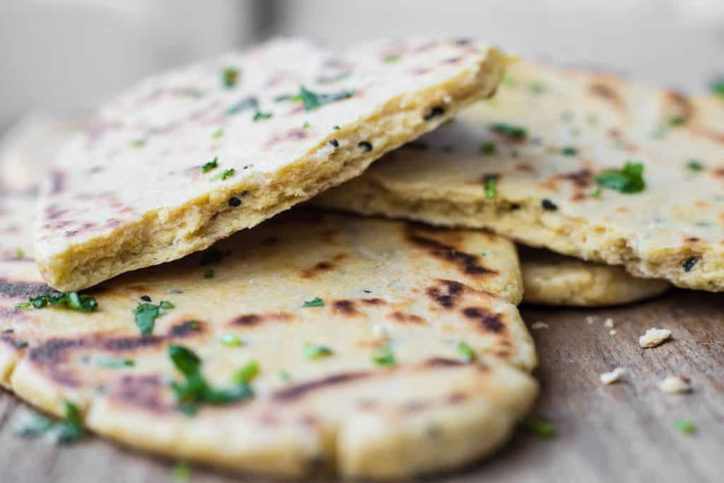 Gluten-Free Naan Bread on wooden board with coriander