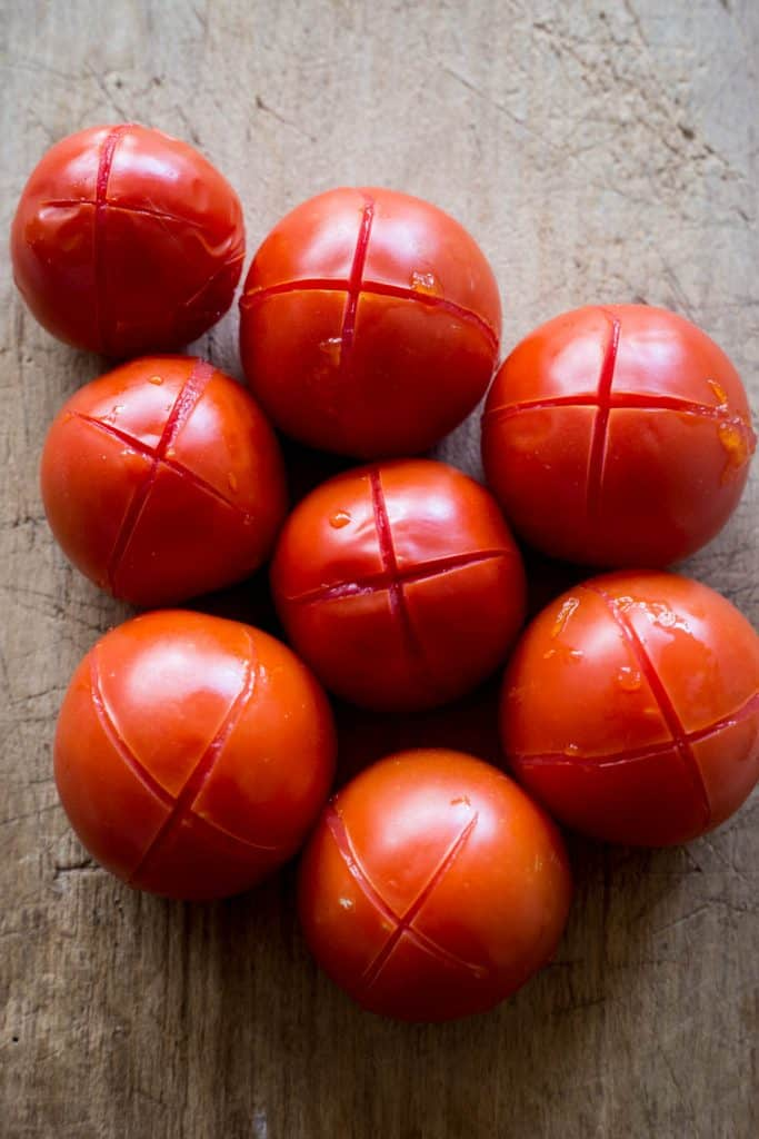 tomatoes waiting for their skins to be peeled