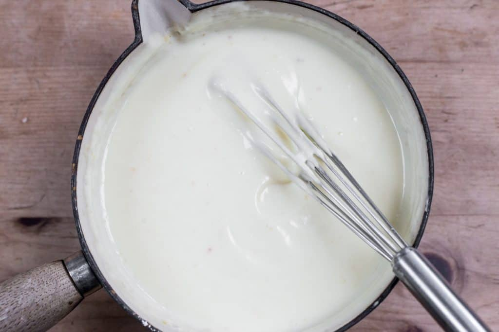 cheese sauce in a saucepan