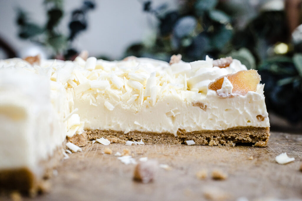 White Chocolate Ginger Cheesecake with a slice taken out