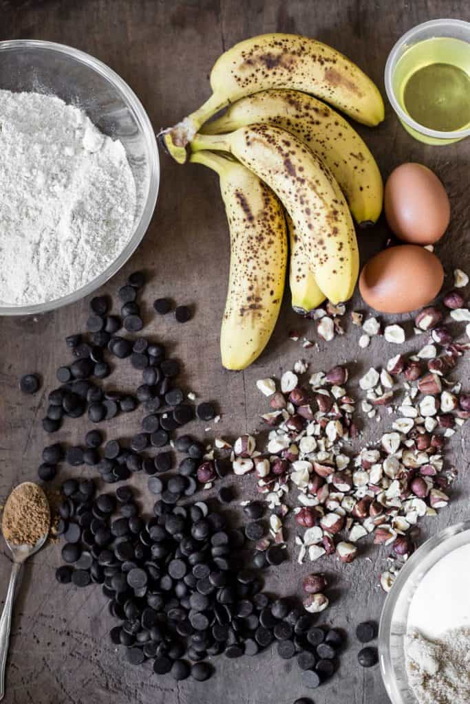 ingredients for Gluten-Free Banana Chocolate Chip Muffins on a wooden board