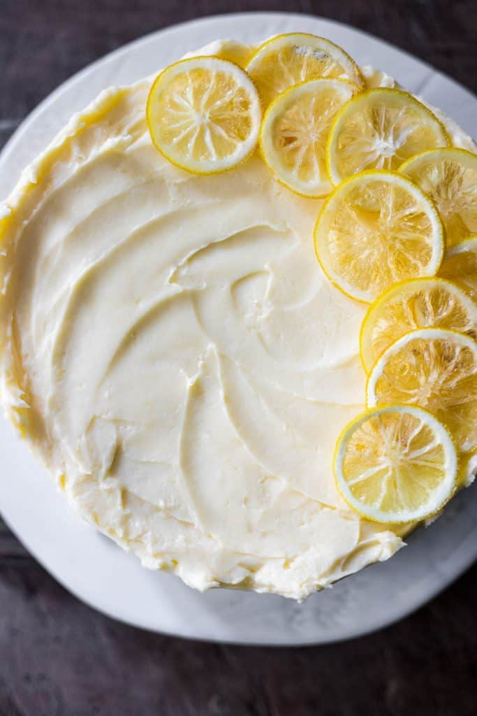 overhead image of lemon curd cake on a white plate