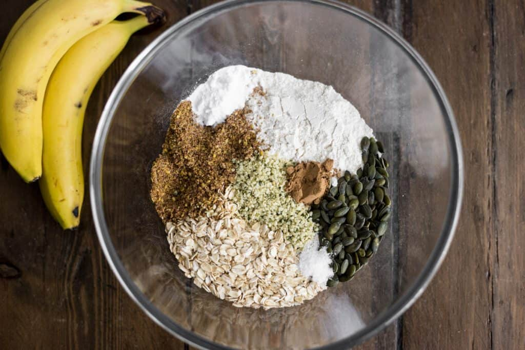 dry ingredients for banana oat bread in a glass mixing bowl