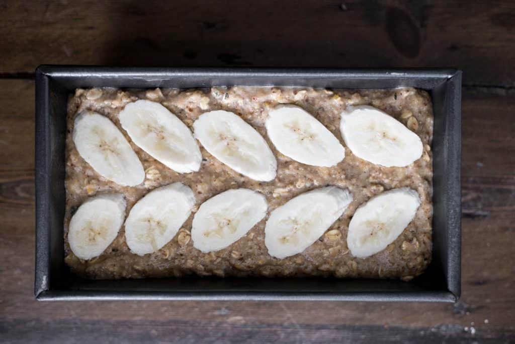 banana oat bread batter in loaf tin ready for oven