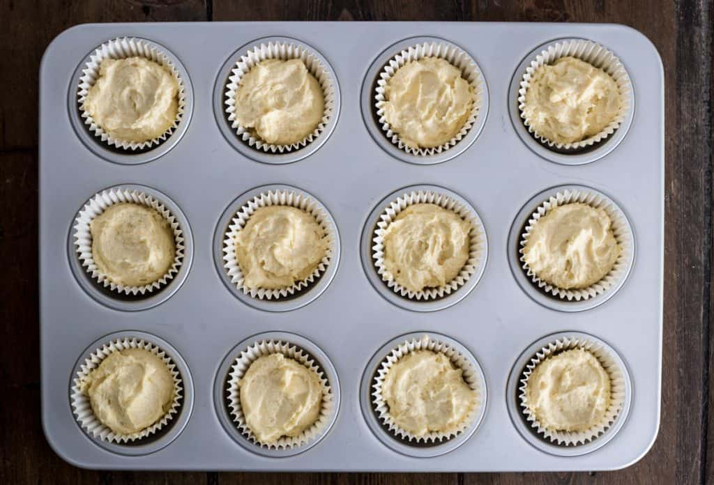 Muffin tin filled with fairy cakes pre-bake, ready for the oven