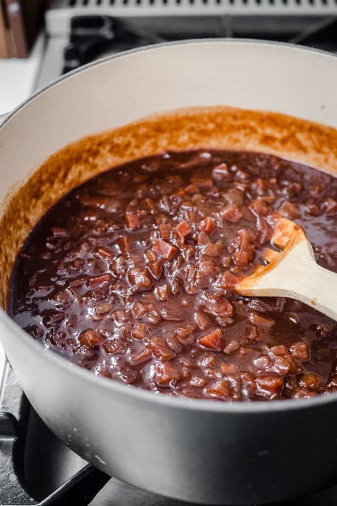 plum and beetroot chutney in a preserving pan cooking on a stove