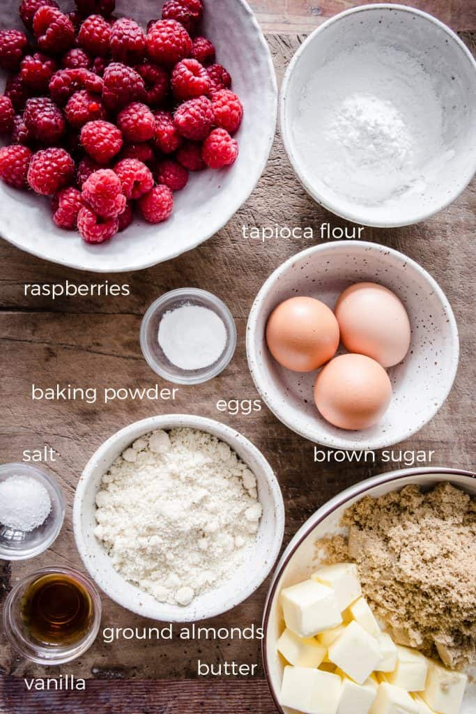 ingredients for raspberry pudding on a wooden board