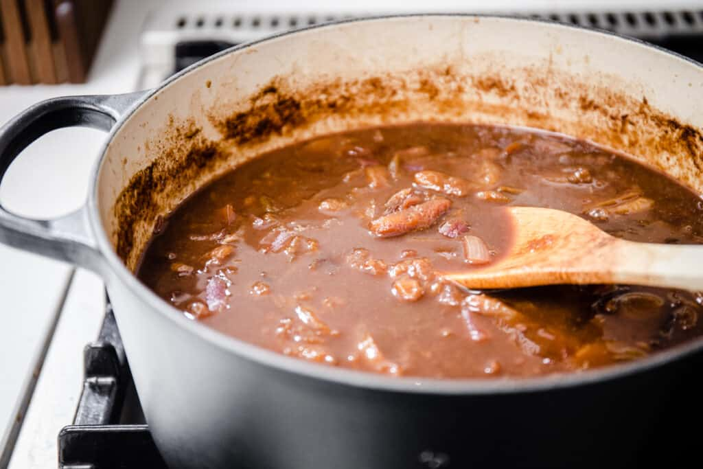homemade brown sauce cooking in a large pan