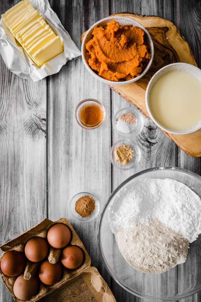 pumpkin pie ingredients on a wooden table