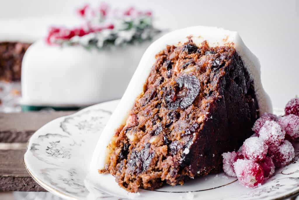Close up of cut slice of Christmas Cake on a plate