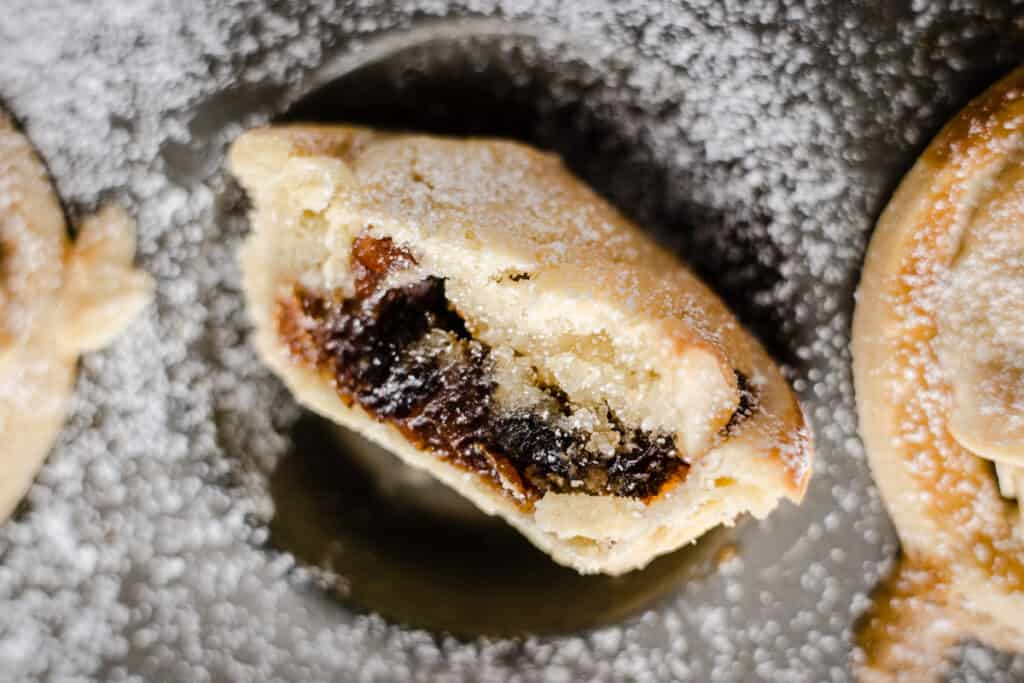 Close up of Frangipane mince pie with a bite taken out