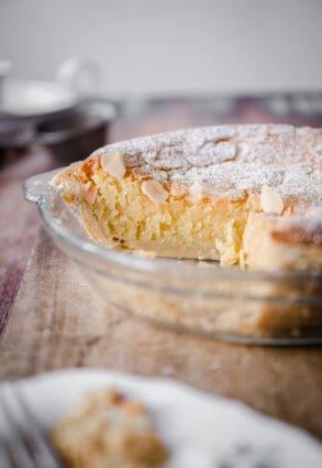 Gluten-Free Frangipane Tart sliced and sitting on wooden board