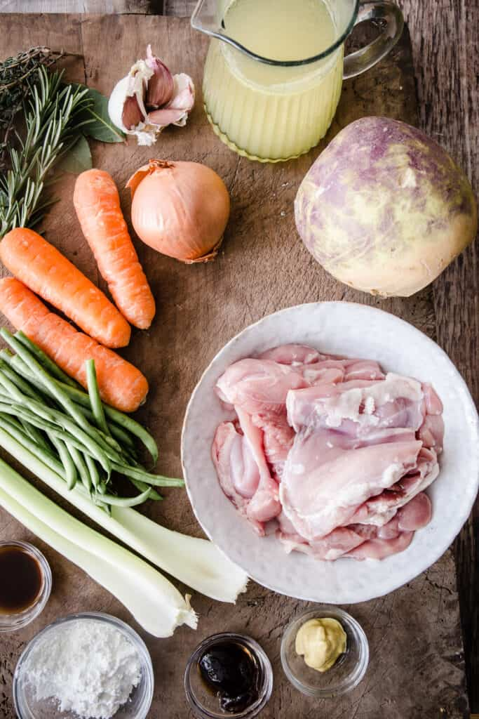 Ingredients for chicken casserole on a wooden board