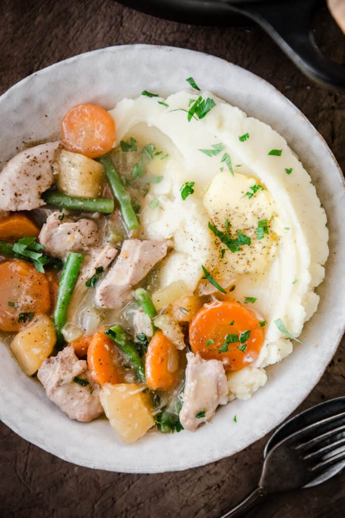 Chicken Casserole in a bowl with mashed potato