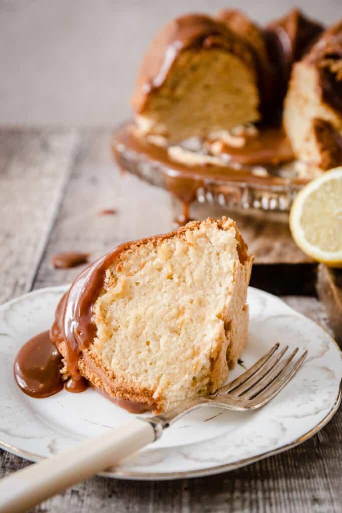 A slice of lemon caramel cake on a plate