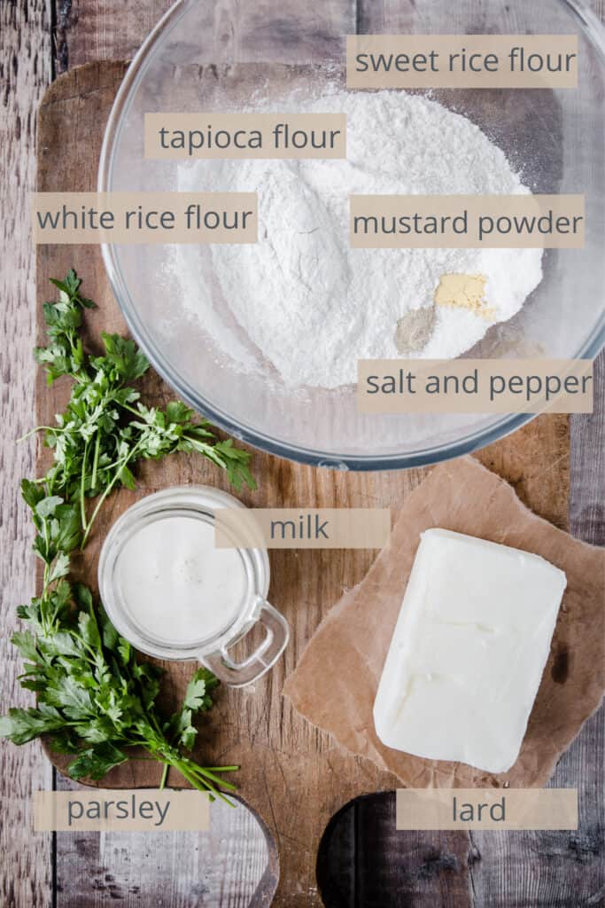 labelled ingredients for gluten-free dumplings on a wooden background