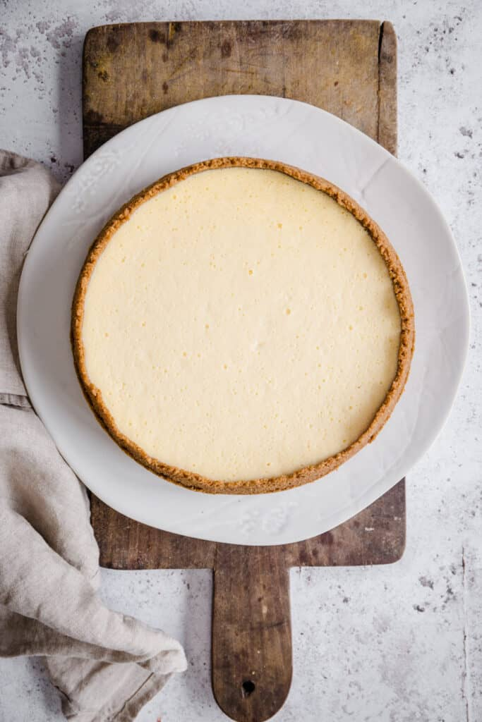 whole cheesecake on wooden board