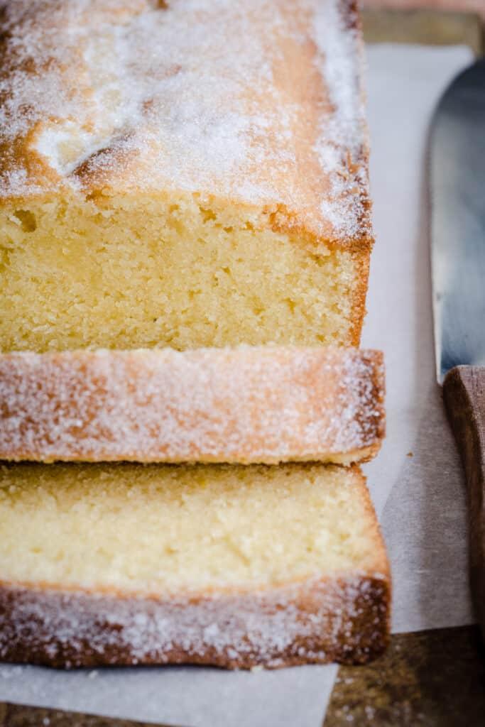 Sliced Rice Flour Madeira Cake next to knife