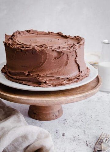 Gluten Free Chocolate Fudge Cake on a cake stand