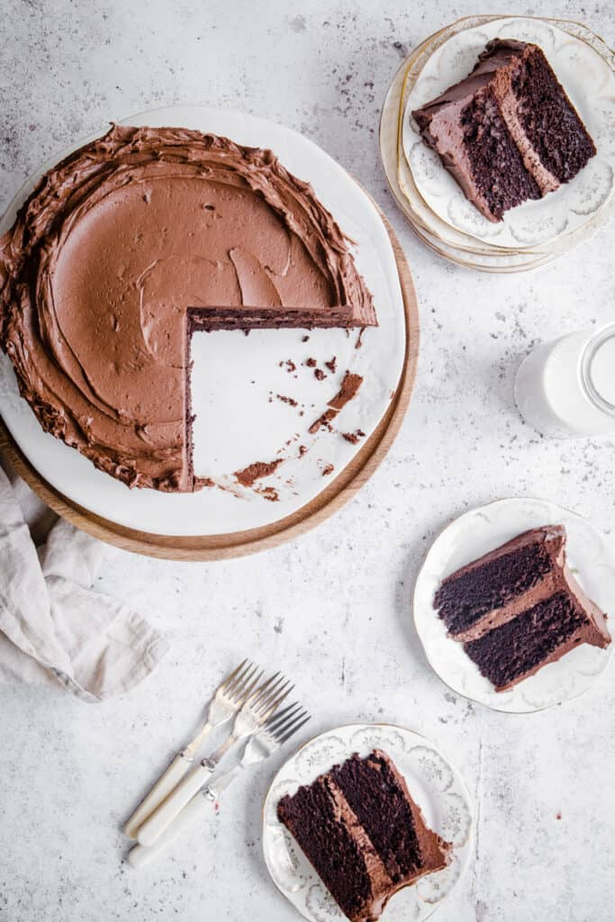 Gluten Free Chocolate Fudge Cake cut into and served out onto plates