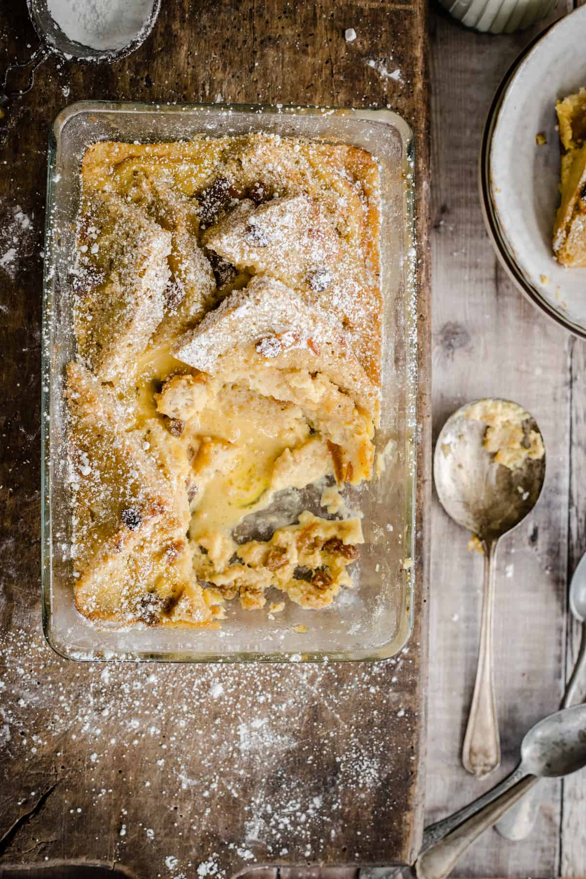 bread and butter pudding in a serving dish with a portion removed