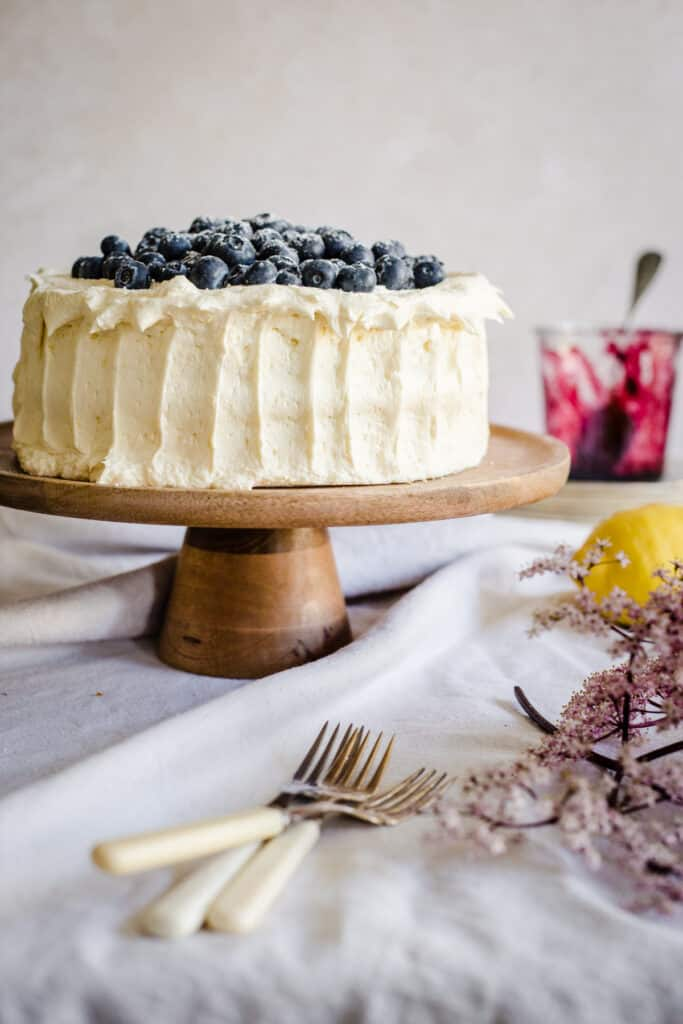blueberry cake on a wooden stand