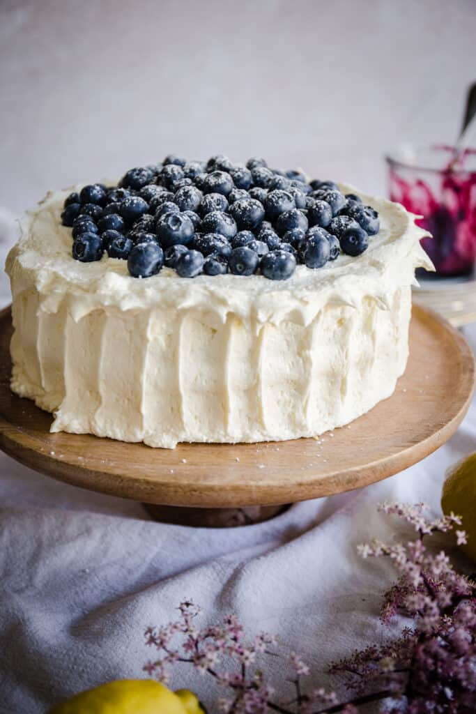 blueberry cake on wooden stand