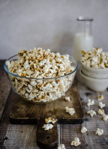 popcorn in a bowl on a board
