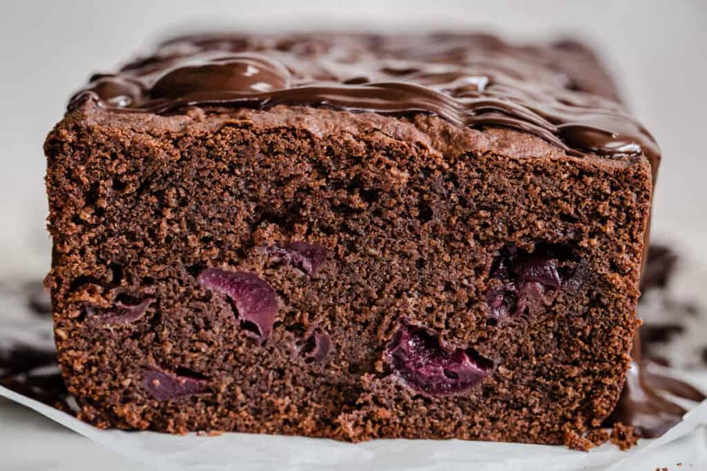 close up of chocolate cherry cake cut