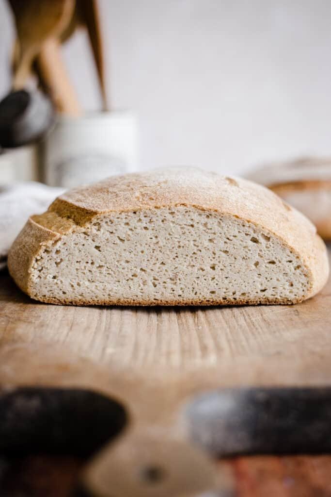 sliced sourdough bread on a wooden board